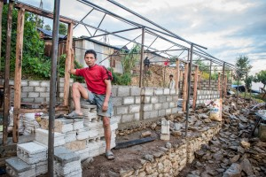 Bhadra Singh Tamang gave up waiting for government compensation and started building a home to withstand the next quake