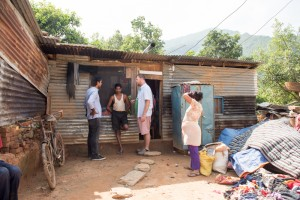 Mark Bibby Jackson, and Jeetendra Thapa interviewing residents of Hattigauda village.